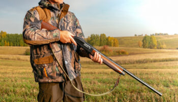 hunting-hunter-camouflage-with-gun-hunting (1)