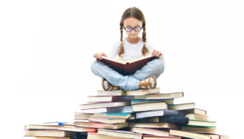 concentrated-girl-surrounded-by-books